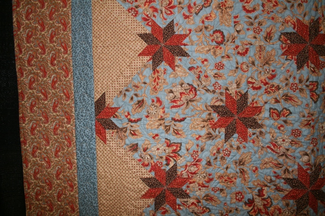 Rapid Fire Hunter's star, quilted by Denise Green.  this was a wedding gift for my son Kyle and his wife Kara in 2010