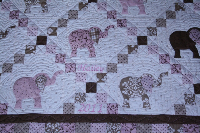 a closer look of the quit for Hailey.  Quilted by Denise Green