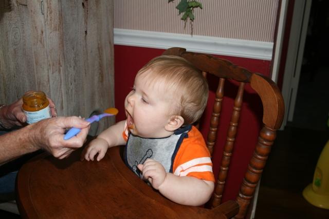 Wyatt loves his squash!  he looks like a bird!  ;-)
