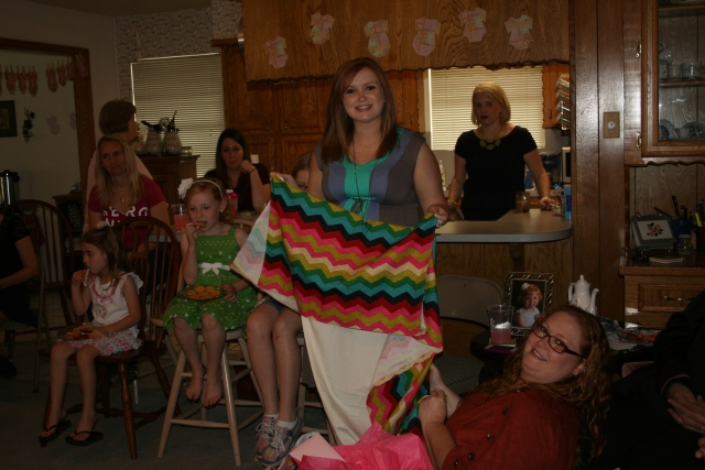 this is the bedskirt that Mom made.  Kara was having a hard time getting it folded.  it was funny.