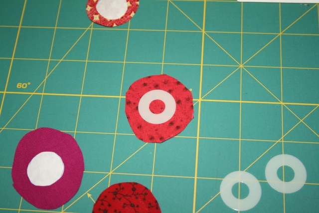 start with these, you want your fabric larger than your circle insert