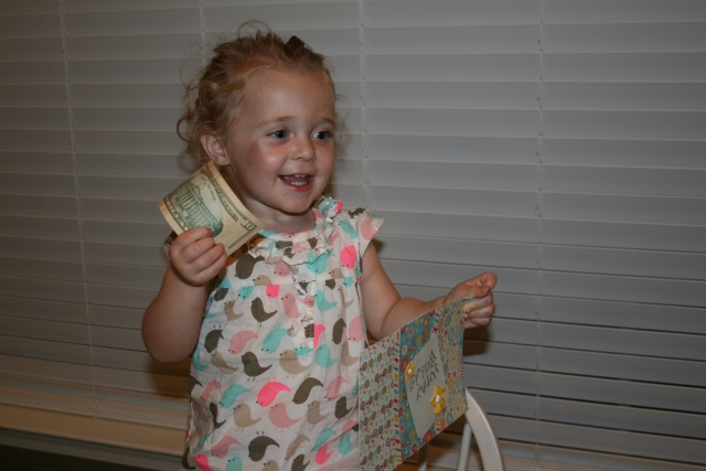 Hailey opening her card from Mom, she said it was a dollar.  she is growing up too fast
