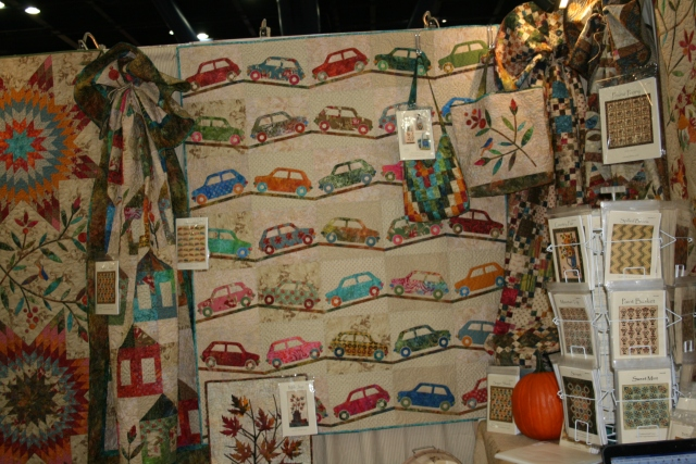 Laundry Basket Quilts' booth.  I love it and the car quilt!