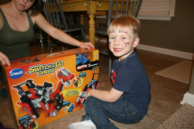 Hunter and his new transformer dinosaur