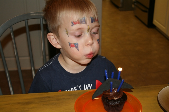 Hunter blowing out his candles