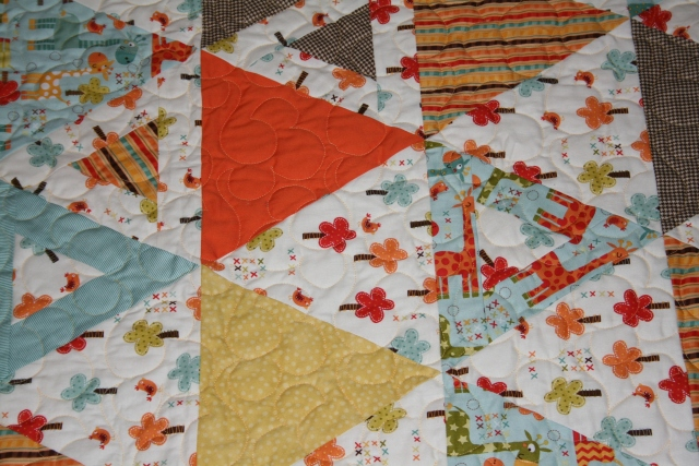 a close up of the baby quilt
