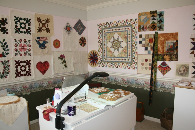 love her design wall and sewing area