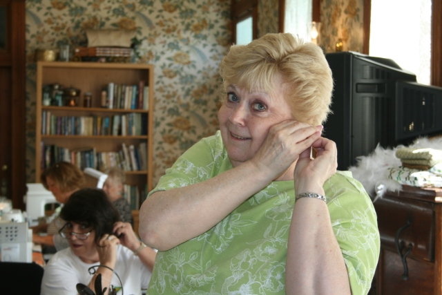 Linda is putting on her earrings too, in fact, we all did
