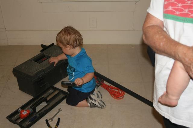 Wyatt working with the tools