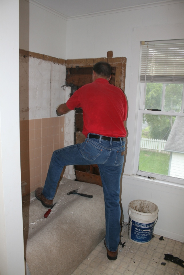 David removing the tile around the tub