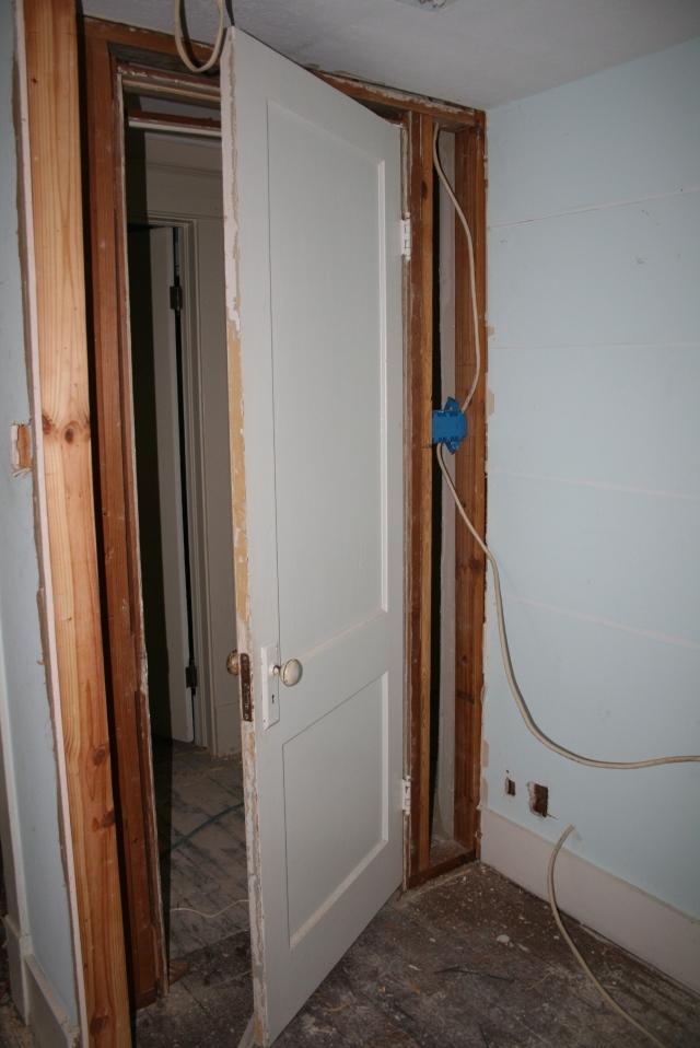the closet door is now in its new home