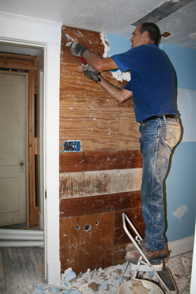 David working in the master bathroom