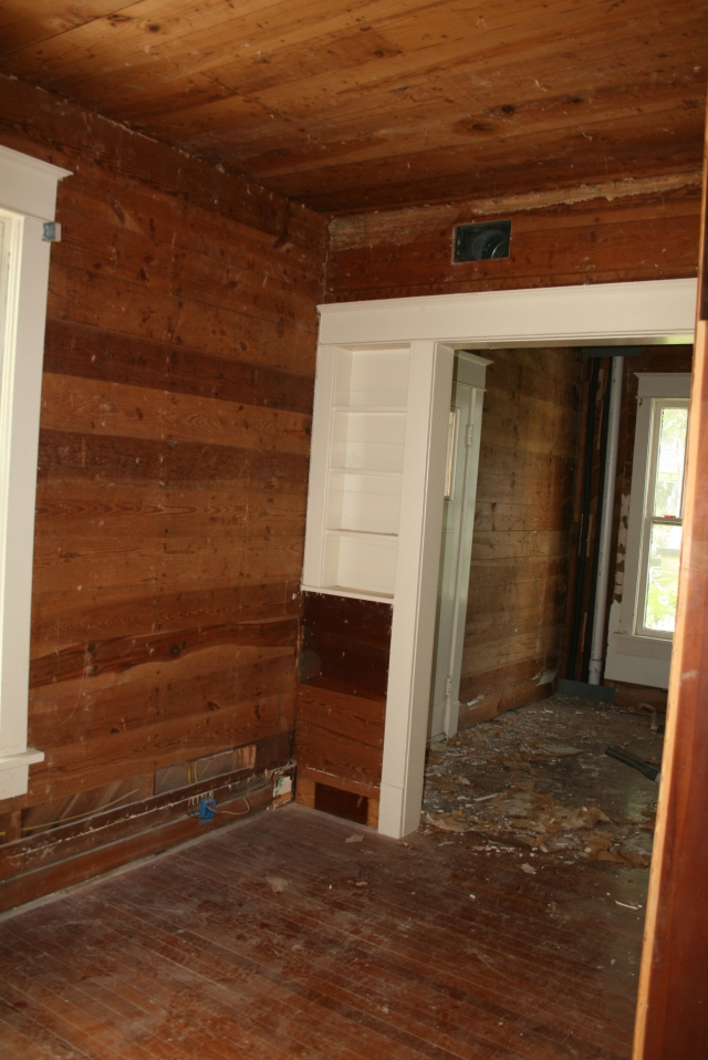 a better view of the wood in the den and entry