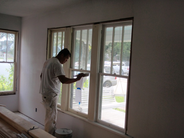 our painter working on the trim in the den