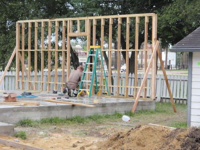 Grant working on the framing