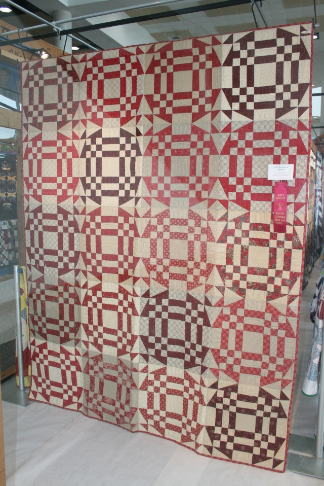 this quilt sure caught my eye!  I love the red and white