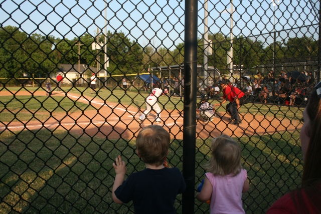 I love this - Wyatt and Kynlee are standing watching Jaiden at bat