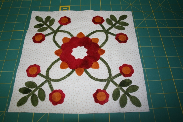 block one with the flower centers on, ready to stitch