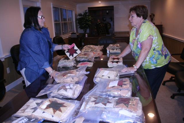 Paula and Mary Ellen sorting all the sawtooth stars