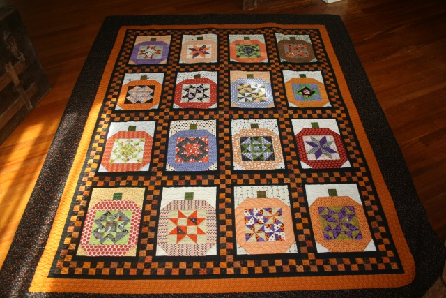 a full view of the pumpkin quilt