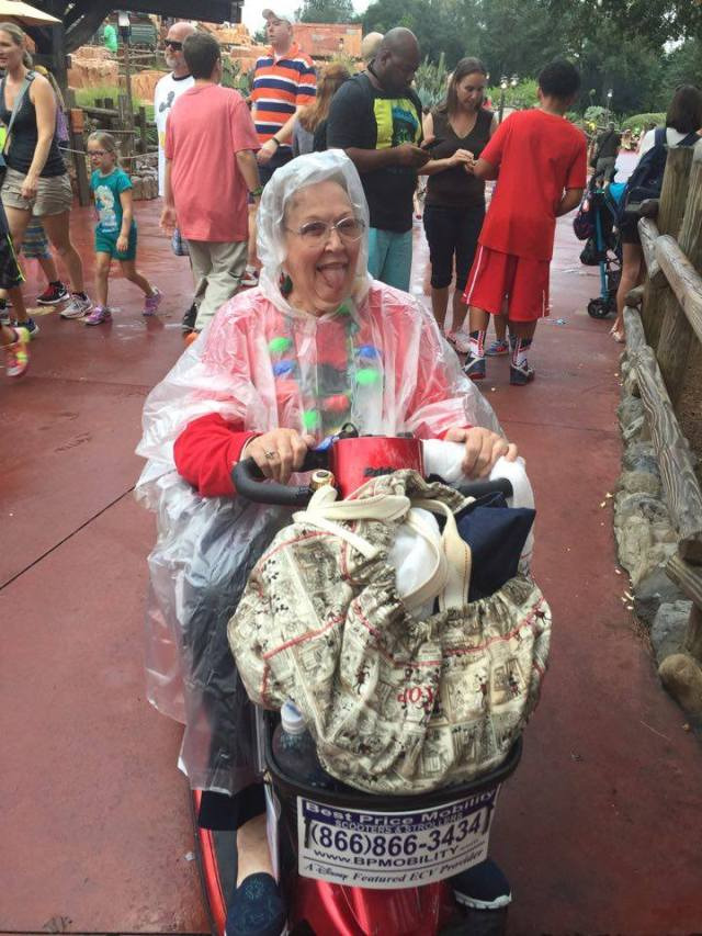 Mom and her raingear at Magic Kingdom