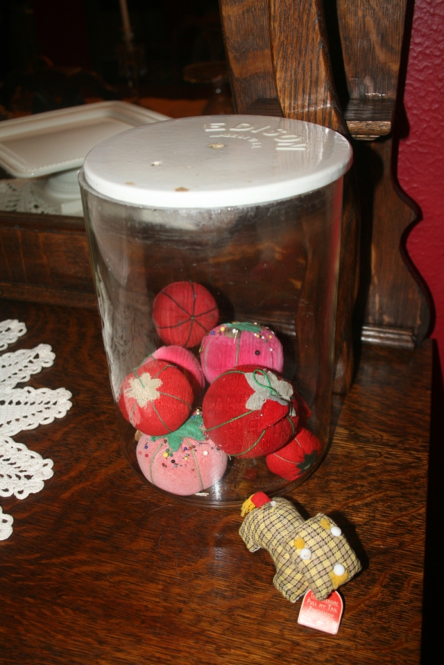 my pincushion collection in the battery jar