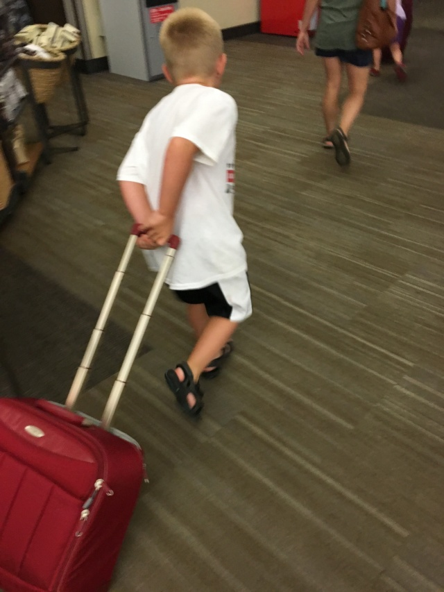 Hunter helping with the luggage