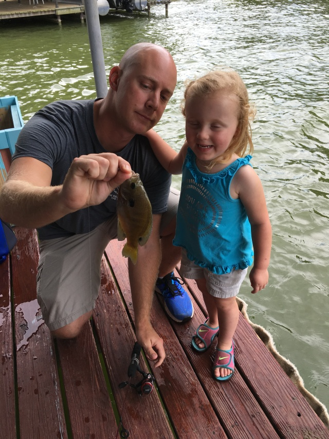 Brok and Adley showing off her fish