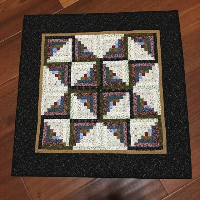 my log cabin star, quilted by Pat Meeks