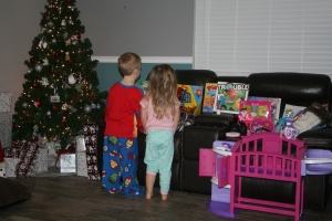 Wyatt and Kynlee just looking at the gifts